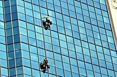 WINDOWS CLEANER... (Rosa Dik 009 -- on& off) Tags: new travel light reflection colors architecture composition buildings dangerous tags glas ohne chelyabinsk glassreflection windowscleaner abigfave photographystudy simplysuperb heavyjob reisenkultur summer2011 nikoncoolpixs4000 russiantrip2011