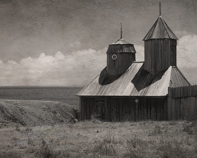 a textured and aged sepia photograph of Fort Ross, California