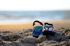 walk on the beach4 (TriggerHappyMe) Tags: blue trees sea sky india feet beach relax sand nikon rocks break dof bokeh sandals goa clam shore footware enjoy unwind d60 laze deptoffield chappals unlax