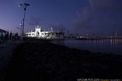 154/365 Piya Haji Ali, Haji-Ali Dargah, Mumbai, Maharashtra - India (Humayunn N A Peerzaada) Tags: india reflection saint lens model streetlight photographer preacher muslim islam faith fisheye tokina holy mausoleum actor maharashtra 365 mumbai baba peer pious humayun moslem dargah d90 mazaar project365 revered tokinalens peerzada anniebesant tokinafisheye nikond90 hajialidargah humayunn peerzaada humayoon wwwhumayooncom anniebesantroad humayunnapeerzaada tokinafisheyelens nikond90clubasia humayunnnapeezaada 10to17mmf3545 landmarkofmumbai islamicpreacher hajialimausoleum piyahajiali