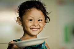 smilin' little girl (puguhindra) Tags: girl smile face indonesia interesting eyes nikon flickr dof bokeh strangers 85mm stranger littlegirl yogyakarta jogjakarta potrait ugm bokehlicious af85mmf14d gadjahmada flickraward 100strangers d7000 nikond7000