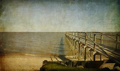 vanishing summer (anniedaisybaby) Tags: lake texture beach pier vanishingpoint sand horizon jenny shoreline manitoba summersend gimli interlake lakewinnipeg flypaper whytewold poplarpier skeletalmess flyedges
