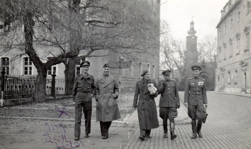 British, American and Soviet officers. Unidentified city.