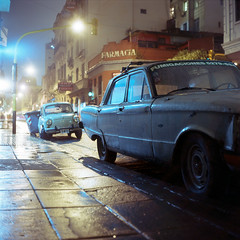(patrickjoust) Tags: auto street old city urban color reflection classic ford 120 6x6 tlr film wet argentina car rain night analog america vintage dark square lens lights reflex focus automobile san fuji mechanical fiat buenos aires south release tripod patrick twin slide cable mat v chrome 124g falcon vehicle epson after medium format parked tungsten ba manual 500 80 joust fujichrome e6 yashica telmo farmacia 80mm f35 reversal yashinon v500 t64 autaut fumigaciones patrickjoust