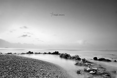 Fragile dreams (J. Tiogran) Tags: longexposure morning sea blackandwhite blancoynegro maana water mar twilight agua nikon rocks stones silk tokina filter lee seda rocas julin silky piedras solana serrano crepsculo anathema filtro largaexposicin nd06 d5000 20tfbnsepia 1116mmf28 julinsolana fragilesdreams