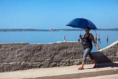 Malecn (hubertguyon) Tags: street city woman mer umbrella island see walk femme cuba ile malecon rue marche cienfuegos ville parapluie amrique amriquelatine