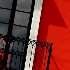 rosewood balcony (msdonnalee) Tags: shadow red rot window rouge ventana rojo iron angle balcony fenster wroughtiron sombra finestra janela ironwork tilt rosso finestre venster wroughtironbalcony
