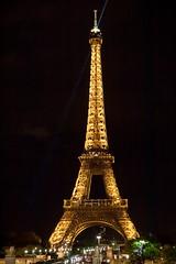 Eiffel Tower at Night (jrobblee) Tags: city light paris france tower night canon french eos golden europe glow famous eiffeltower landmark eiffel nighttime lit arrondissement 7th 50d storybookwinner