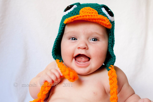 naked baby in a perry hat.