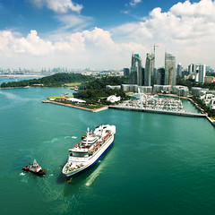 Singapore (Ed Kruger) Tags: ocean park street city blue windows sea sky plants sun seascape reflection tree green water grass sunshine skyline architecture clouds buildings daylight boat singapore asia southeastasia waves ship cityscape niceshot asians horizon may wave sunny vessel cruiseship boating vegetation allrightsreserved yachting cityscene skyphoto 2011 photocity peopleofasia asiancities shipphoto earthasia may2011 edkruger asiancountries photoofocean cultureofasia photosofasia photosofthesky