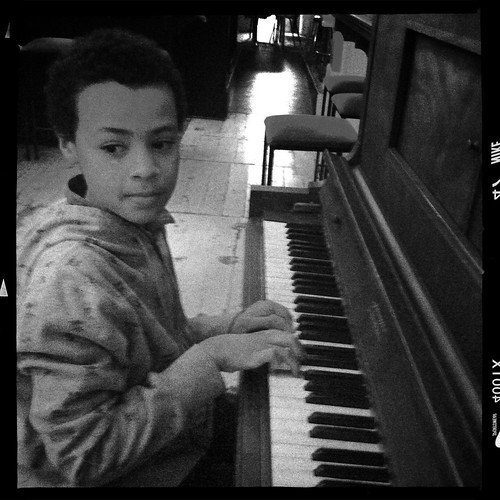Showing us his new piano skills. Day 301/365.