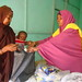 Each mother picks up the therapeutic food packets