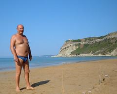 PJ on the north beach at Arillas (pj's memories) Tags: beach seaside greece slip speedo vpl corfu sunbathing speedos bulge arillas tanthru kiniki bearinspeedos huskyinspeedos bearinbikinibrief bearinbiki7nibrief