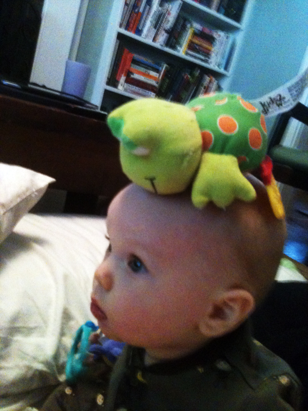Baby Wyatt with a thing on his head.