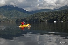 Jenn In Sechelt Inlet (Michael Garson) Tags: ocean trees cloud mountain canada mountains reflection tree nature water clouds forest reflections boat nikon kayak natural kayaking inlet paddling sechelt