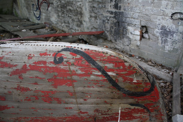 A rotting red canoe carcass...