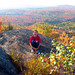 Lydia enjoying fall foliage at the summit of Pinnacle Mountain. Photo: Renee.