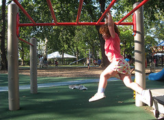 Speck hangs from the low monkey bars