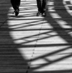 ~ in between ~ (Janey Kay) Tags: bridge light summer bw distortion paris reflection water square puente mono shadows lumière sommer streetphotography nb ponte reflet squareformat micro pont abstraction été brücke spiegelung tiers csc carré ombres quatre passerelle hybride mirrorless formatcarré august2011 janeykay micro43 microfourthirds jkxmas samyang85mm14 photographiedelarue panasoniclumixdmcgh2 compactsystemcamera août2011 dontwalkonthelinesorthebearswillgetyou passerellededebilly