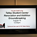 TV monitor reminds folks in Talley of the groundbreaking ceremony.