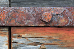 Rusty Dock Fitting (rgarrigus) Tags: wood red brown closeup dock rust decay stained telephoto bolt corrosion greatphotographers garrigus robertgarrigus robertgarrigusphotography