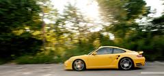 Porsche 911 Turbo. (patmccuephotography) Tags: ohio usa yellow action cincinnati 911 turbo porsche lensflare panaction rollingshot 1755f28