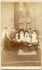 Children on a doorstep (c.1880s) (pellethepoet) Tags: door girls england boys smile fashion kids children shoes boots unitedkingdom hats drain photograph cdv cartedevisite gutter manhole groupportrait sewer manholecover doorstep pinafore waaitg outdoorcdv