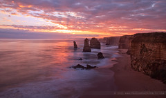 The Great Apostles (The Eternity Photography) Tags: ocean longexposure winter sunset sky cloud sun colour tourism beach nature water set clouds reflections spectacular landscape fire evening nationalpark waves decay au wide australia wideangle victoria filter fallen limestone coastline colourful greatoceanroad twelveapostles 1022mm 12apostles apostles cpl santanu weathering circularpolariser gor 2011 superwide portcampbellnationalpark singhray 60d banik canon60d canonefs1022mmf3545usmlens santanubanik thegreatapostles canoneos60d santanubanik        wwwfrozenforeternitycom wwwmomentsofnaturecom reversedgnd theeternityphotography