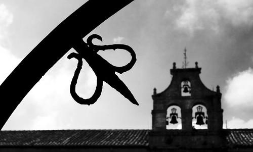 Grille and belfry. Santillana del Mar. Cantabria. Spain. Reja y campanario