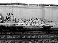 Yukon (BayAreaGraff) Tags: california ca railroad white black cars lines car train graffiti bay smash pacific tag union rail trains tags tagged eros east yukon boxcar eastbay wd hopper freight ekos spade hme handstyles freights btr nts benching