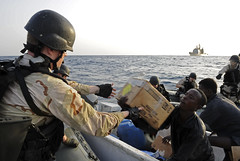 USS Anzio Sailor hands a box of food to mariners aboard a skiff which has been dead in the water for two days (Official U.S. Navy Imagery) Tags: navy sailor usnavy guidedmissilecruiser gulfofaden vbss ussanzio cg68 ctf151