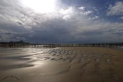Live in the sunshine, swim the sea, drink the wild air. - Ralph Waldo Emerson (genevieve van doren) Tags: sea sky sun mer reflection water clouds soleil sand eau sable ciel nuages hdr cadzand poteaux