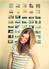 A Laugh by the Polaroid Wall (SOMETHiNG MONUMENTAL) Tags: birthday portrait selfportrait smile wall nikon fuji stripes laugh instant polaroids 28 instax d60 somethingmonumental mandycrandell