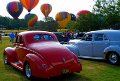 Color is in the Air - Classic Cars and Hot Air Balloons (StGrundy) Tags: usa classic cars car rural vintage balloons georgia nikon colorful unitedstates antique south southern hotairballoon automobiles carshow labordayweekend appalachianmountains pinemountain callawaygardens d80 skyhighhotairballoonfestival