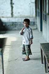 Innocent (puguhindra) Tags: life boy indonesia interesting nikon flickr dof village child candid innocent 85mm jogjakarta nikkor ville lampung candidphotography af85mmf14d flickraward d7000 nikond7000 flickraward5 tegineneng