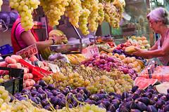 Buying bananas and more fruit (kel0) Tags: valencia fruit fruta mercado bananas marketplace fruitstand grape figs mercadocentral canonef50mmf14usm