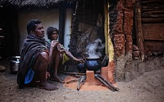 Cooking chai, Orissa, India (ingetje tadros) Tags: travel family light portrait people food orange india color cooking kitchen mystery breakfast composition canon fire photography freedom aperture community asia colours village married faces mud tea candid smoke culture streetphotography 5150 marriage jewelry tribal pot drinks tribes teapot tradition orissa chai aluminium cookware bonding nationalgeographic kitchenutensils villagelife indianculture photoprocessing paroja tribaljewelry internationalgeographic tribaltraditions canon5dmii indiastreetphotography parojatribe ingetjetadros stunningphotogpin best4gpin bestphoto4gpinsep2011 souteastasianlife
