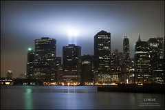 Lights in the Mist (9/11) (Linus Gelber) Tags: nyc newyork fog skyline brooklyn clouds river island memorial 911 eastriver manhattanskyline twintowers beams tributeinlight pier6 canon28135mmisusm pier6park