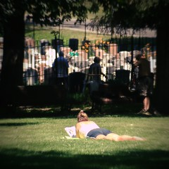 Tanning to death (Ares Tavolazzi) Tags: sun canada girl cemetery graveyard digital lomography montral legs stones tomb tan tanning fauxlomo digilomo digitallomography sfpaward
