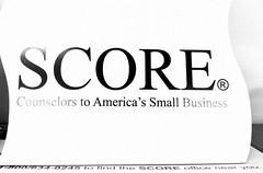 SCORE logo sign