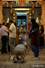 Kneel & bow for a prayer. (Reggie Wan) Tags: singapore asia southeastasia praying hindutemple indiantemple indianmen keongsaikroad reggiewan sonya850 sonyalpha850