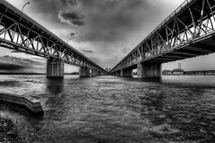Duality (HDR) (Jonathan Grenier) Tags: bridge two sky blackandwhite bw canada black water clouds nikon quebec montreal fisheye tokina dual mercier hdr mercierbridge tokina1117mm tokinaatx107dxfisheyeaf1017mmf3545