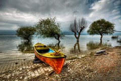 Red Boat (Nejdet Duzen) Tags: trip travel cloud lake reflection turkey boat trkiye sandal bursa bulut gl yansma turkei seyahat uluabatlake glyaz colorphotoaward uluabatgl saariysqualitypictures mygearandme ringexcellence aboveandbeyondlevel1 flickrstruereflection1