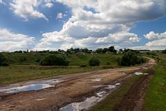 (nekto_nektov) Tags: road sky clouds puddle mud bluesky slush dirt countryroad landsape      badroads      2011 i