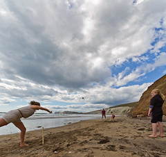 Playing Beach Cricket under Big Skies (s0ulsurfing) Tags: ocean uk sea summer vacation england cliff cloud holiday game english tourism praia beach water sport kids composition canon ball children relax fun island bay coast mar sand holidays skies play action britain pov compton