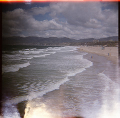 friðsæld (Ceithwyr) Tags: ocean california sky people usa mountains men 6x6 beach water clouds analog america buildings mediumformat la losangeles lomo lomography sand waves fuji iso400 bubbles hills lightleak diana squareformat medium analogue dianaf vignette humans fujipro400h whitehorses fujiflm