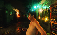 Smoking at Night (Jonathan Kos-Read) Tags: china comfortable asian fat chinese beijing smoking   raining noshirt goldenratio     sigma20mmf18exdg nanluoguxiang naturalbeautyport