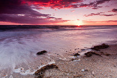 IncREDible. (Olly Plumstead) Tags: uk pink sunset red sea orange sun seascape blur seaweed west english beach water clouds canon landscape sussex se coast sand rocks shingle sigma pebbles foundation 09 lee he olly 06 incredible 1020 hitech holder swoosh plumstead gnd 450d
