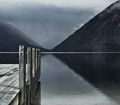Nelson Lakes Symmetry (Tim Bow Photography) Tags: wood newzealand cloud lake storm colour reflection water lines weather clouds dark landscape pier moody cloudy background stormy nelson symmetry quay line reflect nz british welsh inspirational nelsonlakes shutterbug svenska psdtuts timboss81 timbowphotography timbowlandscapesassignment