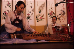 Musicians with Kayagum (Zither) and Changgo (Drum), Seattle (Washington State Folk Arts) Tags: musicalinstruments storytellers narrators verbalartsandliterature kayagums koreanpansoriperformers changgos